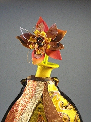 Detail bloom brooch and vase