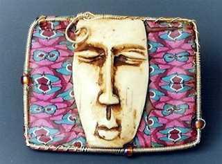 Visage brooch