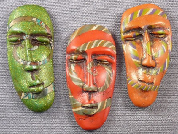 Spiral Mask Brooches